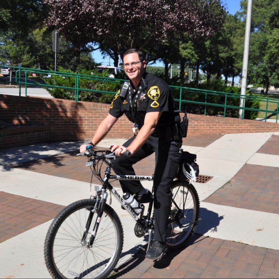 Student Resource Officer Samuel Joyner rides around school on his iconic bicycle.