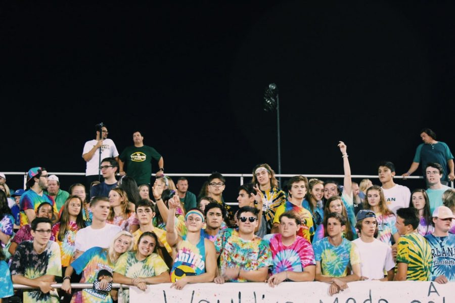 The West Wackos student section displays its school pride during a football game against south Iredell High School. The theme for this game was tie-dye.