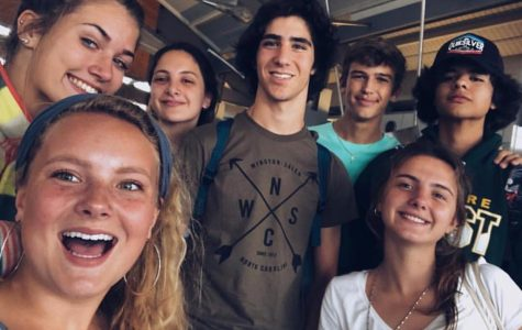 Maddy Brandon and Megan Marshall pose for a picture with their Argentine exchange students.