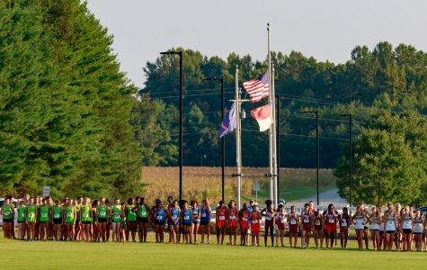 Distance runners line up at the start line at Ivey Redmon Park in Kernersville. The drives to and from meets take away valuable time from said runners.