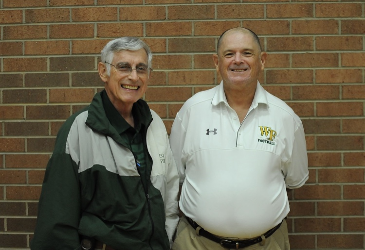 Coach Murph (right) standing next to James Coghill. Murph and Coghill can be seen together throughout campus and at various sporting events.