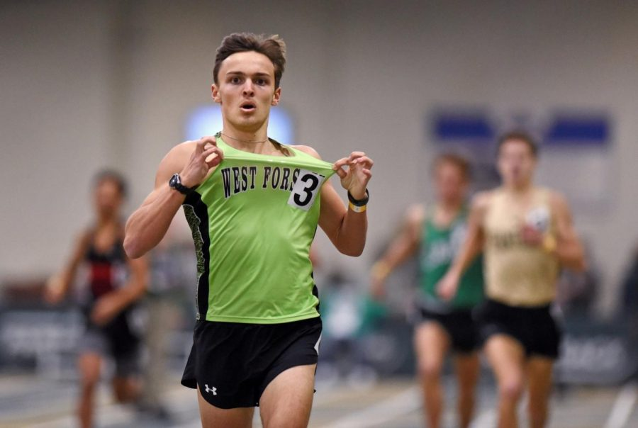 Junior Will Atkins finishes a race. Atkins won the state championship in the 1000 meter race.