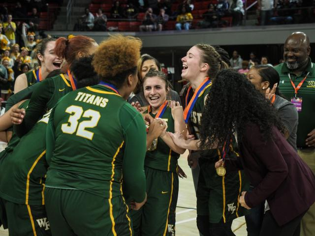 The+Titans+celebrate+their+win.+The+girls+basketball+team+won+the+NCHSSA+4A+State+Championship+game+March+16+at+Reynolds+Coliseum+in+Raleigh.