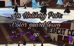 An Unlikely Pair: Winter color guard teams up with Reagan