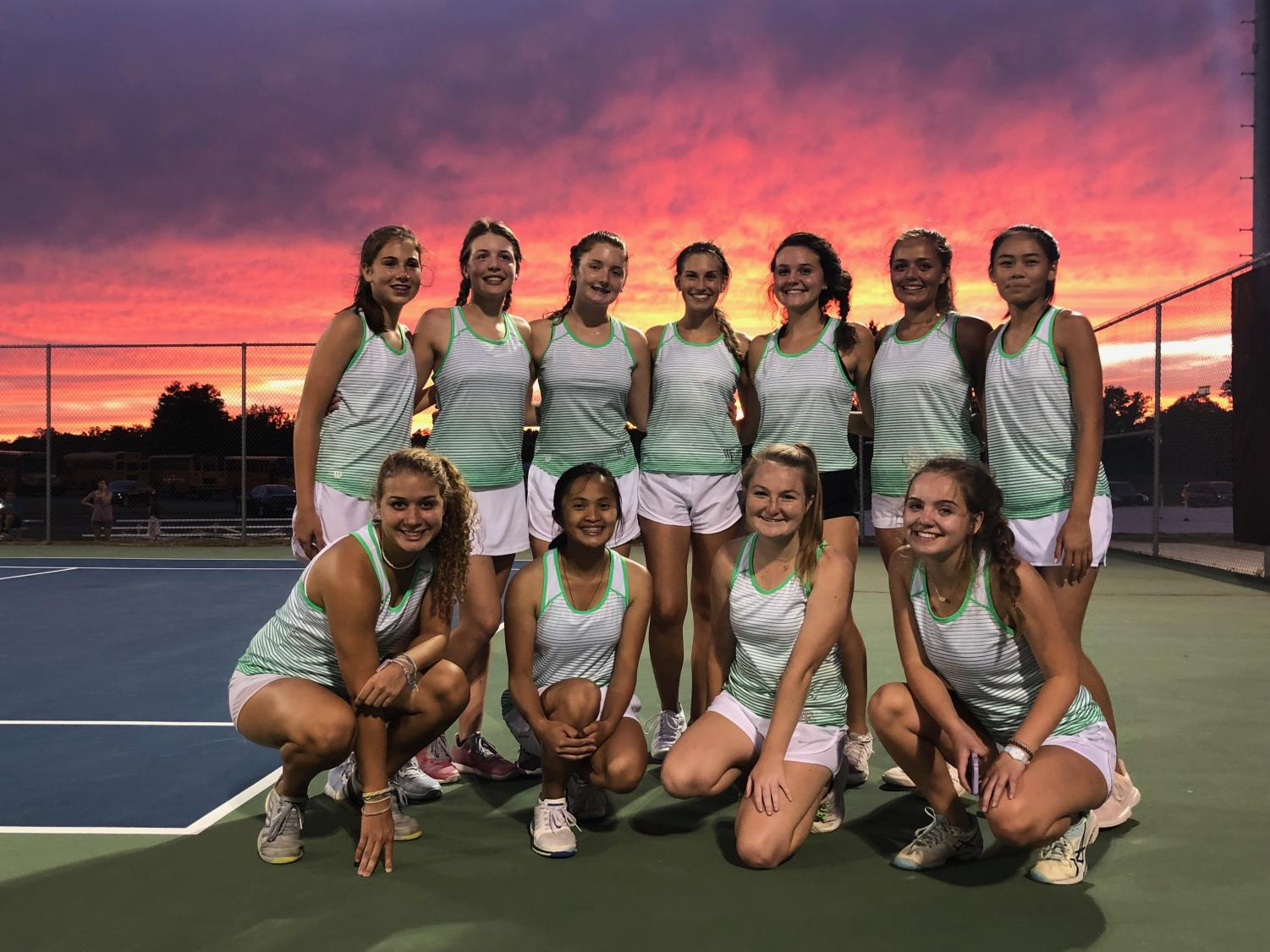 The girls' tennis team stands proud.  They have shined during their season this year.