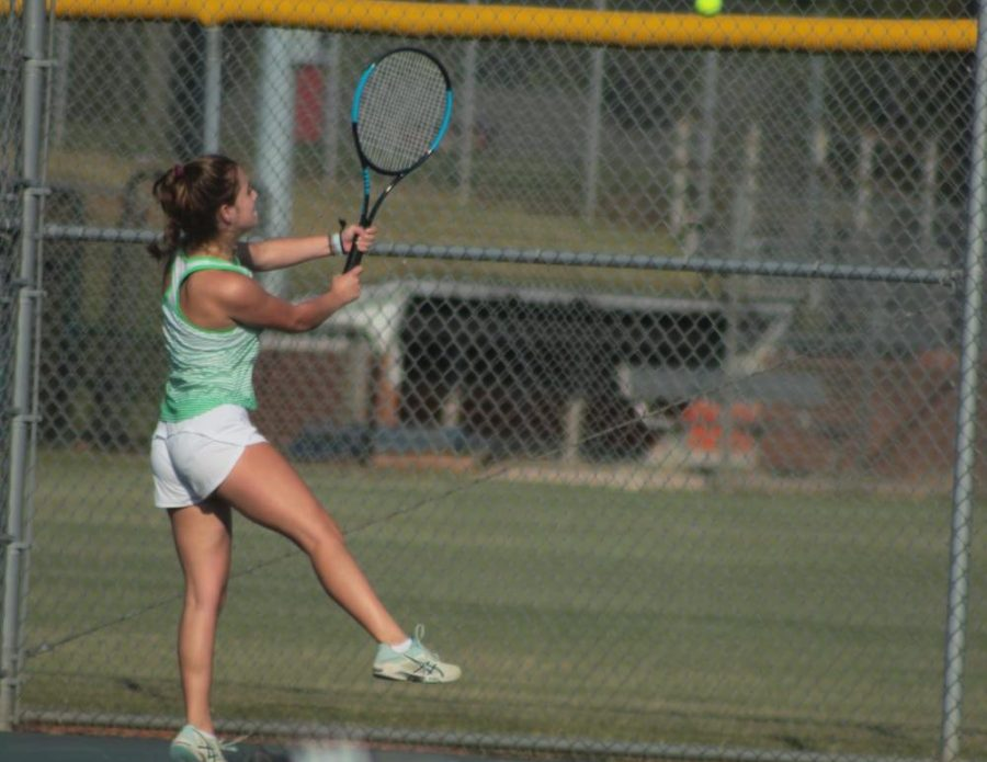 Senior Leah Harding spins a forehand across the net to her opponent. Harding completed her final season being an inspiration to her teammates.