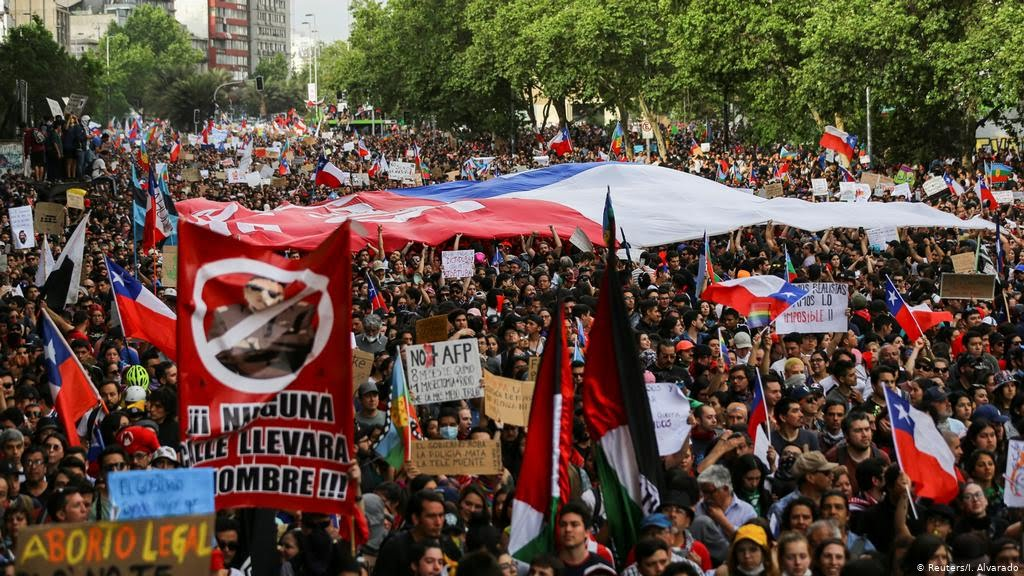 Chilean students protest the government's unfair economic policies. Due to a great wage gap, many students face an abundance of student debt.