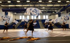 Winterguard practices routine with flags. Currently their championship has been canceled. Picture Credits: Alex Westover