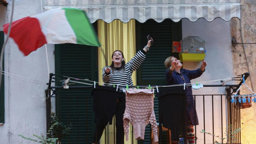 Italians take to their balconies to singing and play instruments during coronavirus-induced social distancing.