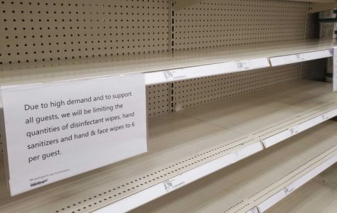 A store has nothing in stock as it's shelves has been ravaged by customers looking to stock up on supplies.