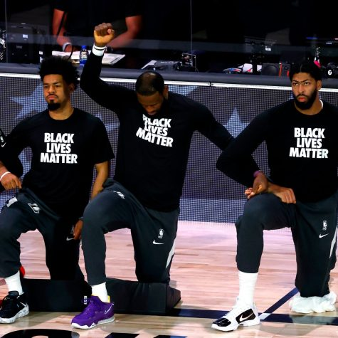 LeBron James and the Lakers kneel during the national anthem. This has become a popular trend among athletes seeking social justice.