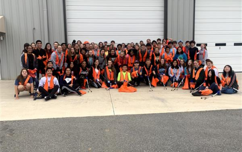 Key Club taking a group photo. Key Club comes together after working hard.