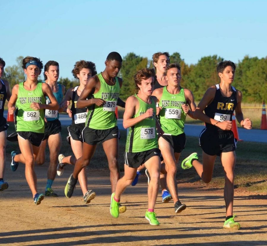 Cross country runners competing in a race last year. After graduating seniors Drew Okon and Will Atkins, the team looks to Jeremy Eldredge and Jackson Nichols to lead them.