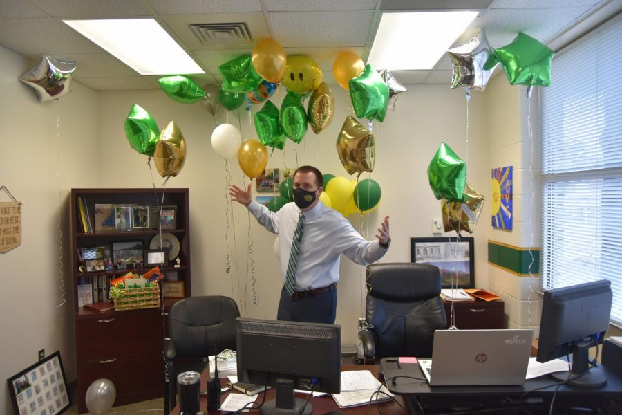Principal Kevin Spainhour takes a moment in his new office after walking the campus on his first day. Teachers welcomed Spainhour with a plethora of balloons throughout the day.