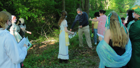 """From left to right, Caroline Hoover, Alice Efremov, Laurel Chiesa, Summer Neace, Jacob Cook (music director), Nevaeh Middleton, Renae Hubbard, Sydney Bean, William Bland and Victoria Lugo are filming for their final recordings of their production, """"Into the Woods."""" They are all excited to see their hard work during these difficult times pay off."""