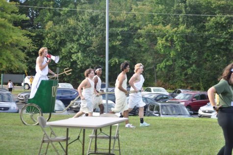 The Latin club charged through the tailgate offering chariot rides and help with wrapping togas.