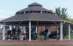 None of the Above performs in Shallowford Square. Their music is a distinct blend of bluegrass with each band members personal style.